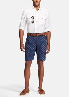 Resort casual | White sport shirt paired with nautical print shorts. Add brown accessories to finish a daytime look.
