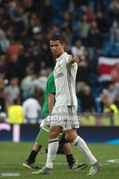 Real Madrid's Portuguese forward Cristiano Ronaldo gives the thumbs up to supporters at the end of the UEFA Champions League football match Real...