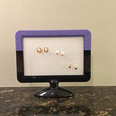 Purple earring holder, Jewelry organizer, Picture frame, glittered frame, body jewelry holder, girl's earring holder, double sided frame by CreativeCraftRooms on Etsy https://www.etsy.com/listing/451825760/purple-earring-holder-jewelry-organizer
