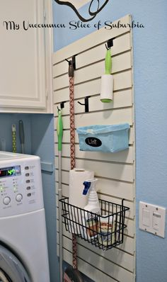 Organized Laundry room - great idea; can use pegboard if slatboard is not available...