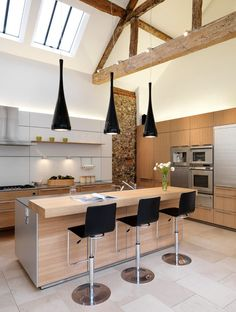 Kitchen bar lights kitchen contemporary with exposed wood beams built in wooden cabinets black adjustable height bar stools