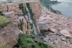 Niagara Falls Dry by wbryan, via Flickr.  In 1969 the army corps of engineers stopped the flow over the falls down to a trickle by making a temporary dam.  They needed to clean it out and get rid of a pile-up of rock debris that had accumulated on the American side of the falls.  The dam was made of 30,000 tons of rock and measured 600 feet across.