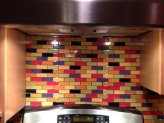 LOVE this custom designed multi-colored subway tile backsplash! Bright glass…