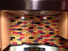 LOVE this custom designed multi-colored subway tile backsplash! Bright glass…