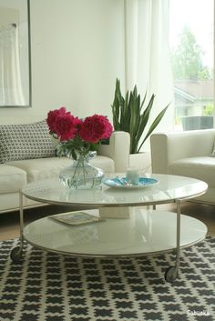 pink pionies in a black and white living room