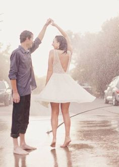 Dancing in the rain .. Love