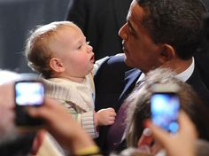 President Obama with a young consitutuent by Michael in Silver Spring, via Flickr