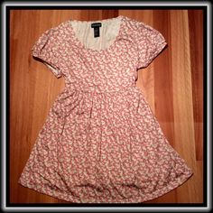 DYNABELLY by  DYNASHAPE PREGNANCY TOP ✨ NWT ✨ DYNABELLY by DYNASHAPE lovely top with tags.  Flowery fabric is made of a polyester/rayon blend.  Top has slightly capped sleeves. Machine washable. Elastic tie adjusts as needed. Very sweet.                                     ( Dynabelly by Dynashape Tops Tunics