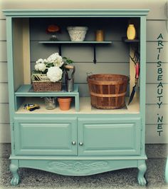 I love this!! she took an old armoire and transformed it into this stylish garden tool center. love love love