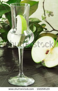 green apple grappa with fruit on ardesia - stock photo