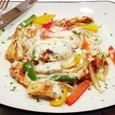 Toss together tender chicken morsels with spaghetti, a rainbow of bell peppers, loads of garlic, a little onion and creamy Alfredo sauce, and you get Chicken Scampi right in your own home.