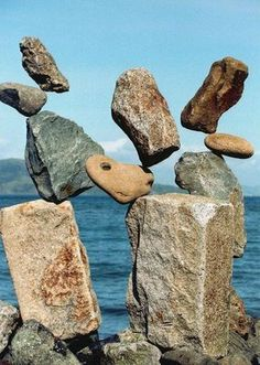"""from thestone blog- this constructions is by Bill Dan  who """"spends much of his time on the waterfront shoreline of San Francisco Bay, which offers ample opportunities for rock balancing. Large quantities of erosion control material called """"stone riprap"""" have been placed to prevent storm and tidal damage"""" and youu can watch a utube video of him at work and read more if u click thru to the blog post"""