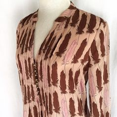 """Fossil Riley Feather Print Tunic✨Host Pick✨ Charming feather print tunic in peach, brown and pink tones. Pintuck detail with eight buttons on the bodice. Three-quarter sleeves with button closure. This looks great both as a dress and a top. 100% silk. Dry clean. Size XSmall. Bust: 18.5"""" flat across. Waist: 18"""" across. Length: 32"""" shoulder to hem. Shoulder to shoulder: 14."""" Like new condition. Fossil Tops Tunics"""