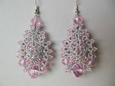 Gentle filigree earrings are hand tatted with silver thread and pink seed beads. An original design, these delicate, lace dangle earrings are unique and lightweight. Using the French technique and a small tatting shuttle, I create intricate designs of beads tatted onto strong thread. Each earring has over 100 glass seed beads, pink color and hand tatted onto a silver color polyester/metallic thread combinations. Complement the design earrings 4 beads- crystals. A silver color French ea...