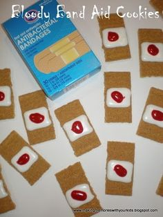 This would be such a good snack to bring for a school halloween party ! :) Bloody Band Aid Cookies:  Graham crackers; marshmallow creme; red frosting gel