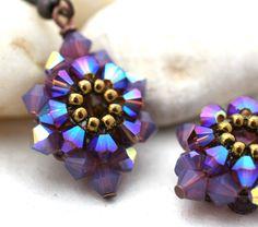 Purple Starburst Crystal and Copper Earrings via Etsy.