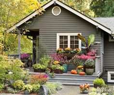 Bring quick color to your landscape with an asymmetrical arrangement of container gardens: http://www.bhg.com/home-improvement/exteriors/curb-appeal/ways-to-add-curb-appeal/?socsrc=bhgpin032615curbappealinaday&page=5