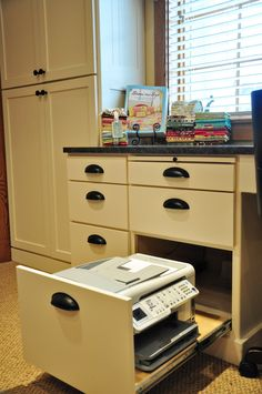 Roll out printer for study with cords for plug in inside the cabinet.