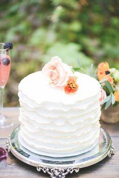 white wedding cake #whiteweddingcake http://www.weddingchicks.com/2013/12/02/peach-and-purple-wedding-inspiration/