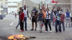 South African police fired rubber bullets Friday to disperse crowds setting immigrant businesses ablaze as attacks against foreigners spread to Johannesburg.