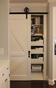 Barn Doors - storage space is always at a premium. Sometimes in those nooks there simply isnt space for doors that open. Tucking those essentials behind a sliding door is a great solution.
