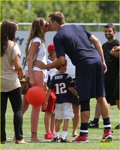 Gisele Bundchen and her husband Tom Brady share a kiss while spending time at the New England Patriots' football training camp on Wednesday (August 8) in Foxborough,