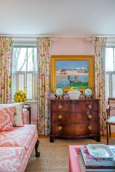 traditional, English living room. floral draperies pink, butter, white, and stained furniture, gold picture frame