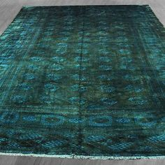 This beautiful one of a kind rug was handknotted in Iran. It is semi antique good condition. Color is forest green, teal Materials: Wool Care instructions: professional rug wash only Dimensions: 9' x 13'8 Weight: 65.35 Country of origin: Persian