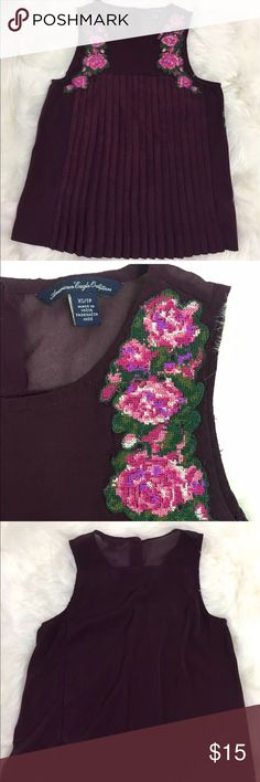AE Burgundy Blouse planks front size XS American Eagle Purple embroidered Flowers XS top blouse. In great condition. Beautiful dark purple wine color light satin feel fabric with planks on front. Please feel free to contact me with any questions.  