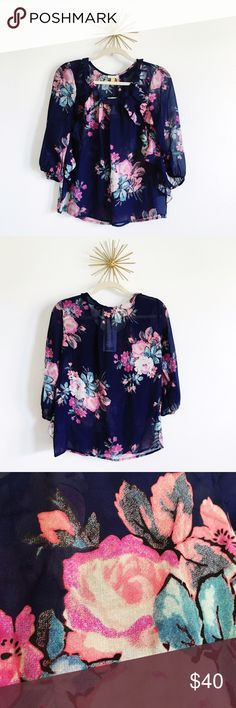 ♡HP♡⚬Anthropologie⚬Leifsdottir Floral Printed Top Gorgeous navy top with pink, blue and coral floral print. Very feminine and flattering with slight ruffle detail on the sides. 3/4 sleeve and NWT. Bundle and save!  Anthropologie Tops