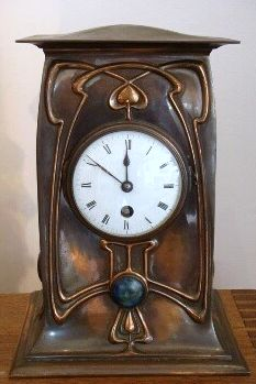 """English Art Nouveau / Arts and Crafts copper cased 8 day movement mantle clock with stylised repoussé design and three ruskin type ceramic cabochons, by noted manufacturer William Tonks & Sons (stamped marks); c1905. Approx. 11.5"""" high."""