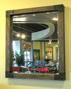 This mirror brings out the industrial trend with hammered metal corners and wood finish showing off the natural grain and texture.