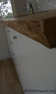 A timber slab kitchen bench