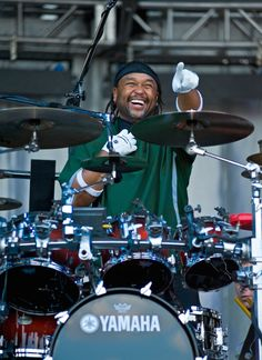 """Carter Beauford - Dave Matthews Band. I listen to him and I feel like quitting. His hi-hat work is enough to keep me in the basement for a month practicing. I got his instructional DVD """"Under the Table and Drumming"""" and I sit down and watch it like I would an actual movie. Love this guy!"""