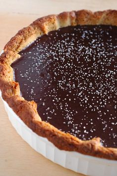 A Gateau Basque tart crust elevates this classic salted dark chocolate caramel tart to another level. Velvety sweet caramel and chocolate ganache are beautifully offset with crunchy sea salt. Chocolate Caramel Tart, Chocolate Desserts, Chocolate Ganache, Easy Desserts, Delicious Desserts, Yummy Food, Cupcakes, Cupcake Cakes, Bundt Cakes