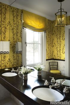 The powder room's existing citrus-yellow wallpaper looks even fresher with the addition of a window shade in a chartreuse-yellow silk, trimmed in Barbara Barry's Tang Tassel — both by Krave.   - HouseBeautiful.com