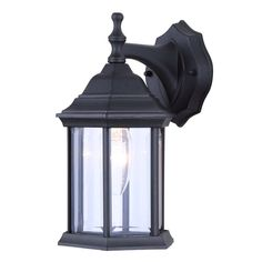 One-Light Exterior Wall Lantern Light Fixture Sconce Outdoor Downlight, Matte Black. This fixture exudes warmth with its matte black finish and clear beveled glass panels. Install this lantern by your front or back entryway or garage door. Outdoor Sconces, Outdoor Light Fixtures, Outdoor Wall Lantern, Outdoor Wall Lighting, Sconce Lighting, Lantern Lighting, Backyard Lighting, Lighting Ideas, Exterior Wall Light