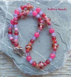 Artisan lampwork glass and gemstone bead necklace.  www.facebook.com/bubbasbeads