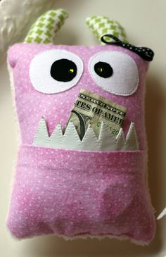 What a funny Tooth Fairy pillow!  I think my little men might like a toothy monster (minus the bow) way more than a cute heart or fairy pillow!