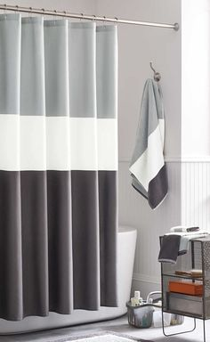 13 Ideas For Creating A More Manly, Masculine Bathroom // A simple color blocked shower curtain is both timeless and gender neutral.