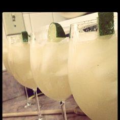Beergaritas! Can of frozen limeade, 12 oz. tequilla, 24 oz. Sprite, one Corona Light. Best. Margarita. Ever.