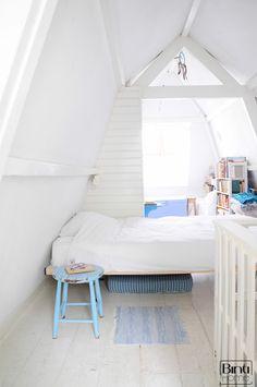 Small attic bedroom. Love the small color pop!