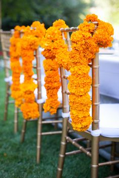 Orange carnations turned chair decor | Photography: Sabine Scherer Photography - www.sabinescherer.com  Read More: http://www.stylemepretty.com/2014/08/06/indian-summer-outdoor-wedding/