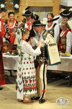 Bride and groom in folk costumes from the region of Podhale, southern Poland [source].