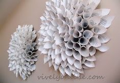 These are cool: DIY wall art dahlias! Made w/ upcycled text book. I have an idea for these . . .