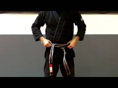 Here is the proper way to tie your Brazilian Jiu Jitsu belt. Fold your belt in half and find the��_