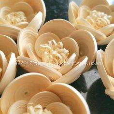 Intricately designed white quilling flowers handmade by artist Sayali Khedekar.