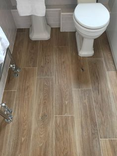 A lot of effort and detail has gone into creating porcelain planks which mimic real wood. We think the Aged Oak Porcelain does this brilliantly. #TileEffectLaminateFlooring Tile Effect Laminate Flooring, Wood Effect Floor Tiles, Wood Plank Tile, Wood Tile Floors, Wood Floor Bathroom, Bathroom Flooring, Kitchen Flooring, Small Toilet Decor, Toilet Tiles