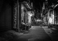 The Comfort Zone  The man relaxes in the back alley of Longshan Temple in Taipei.    We offer different sizes and substrates to print. Also available in iPhone 6 and iPhone 6 Plus covers #street #taipei #comfort #relax #photography #longshen #temple #alley #night