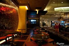 Yellowtail Sushi Bar in the Bellagio - love the wall treatment and how it is up lit from the floor boards